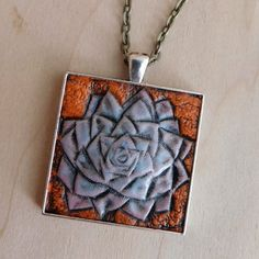 Hand-Tooled Leather Succulent Pendant by JosieDybeDesigns  #Leather #Southwest #Fashion #JewelryDesigner #handmade #Necklace #terrarium #succulent