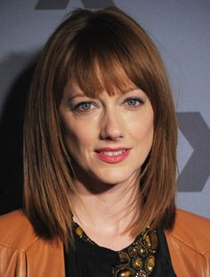 Judy Greer Medium Haircut: The sleek medium length hairstyle can beautifully frame the jaw-line showing off the jagged cut layers throughout the sides and back which enhances shape to the simple length. The smooth straight style with brow-grazing bangs can frame your face and make the low-fuss mid-length bob superbly. The subtly layered bob is …