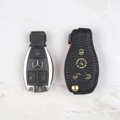 Handcrafted and sized to fit the specified car make / model Brass screw to key securely hold your key in place Pebble grain genuine leather for premium elegance and durability Make sure your car key looks like one pictured prior to purchase to ensure proper fitting See below for compatible car key models Contact us if your car make/model is not listed Finest Craftsmanship GuaranteedShips in 3-5Business DaysInternational Shipping Available100% Secure Shopping Leather Key, Leather Cover, Mercedes Accessories, Leather Coasters, Key Covers, Car Makes, Black Pebbles, One Pic, Flat Head