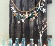 Hanging seashells and starfish. Love! Maybe for over the favor table?