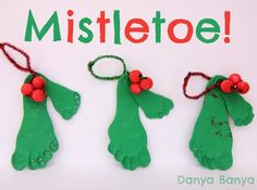 Mistletoe! Or should I say mistletoes? Here's a DIY Christmas craft with baby and toddler footprints that will make your ovaries sing.
