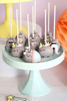 PUSHEEN BIRTHDAY PARTY pusheen-cake-pops. These are not hard, but if you are challenged make round ones pinch up ears and draw Pusheen faces. They will still be Pusheen.