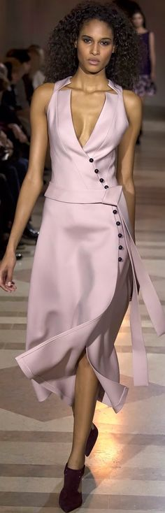 I like the button detail, how it follows the curves of the body. Of course, it needs sleeves & a higher neckline...