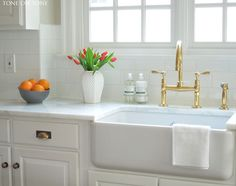 "Tone on Tone. A kitchen makeover with paint, new marble countertops, farm sink, faucet and 4"" x 8"" subway tiles"