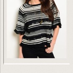 FRINGE SWEATER Black and white sweater w fringe. Zipper in back at neck. New without tags. Retail item Tops