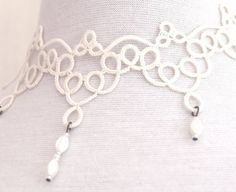 Interesting inspiration for working white/ivory pieces without many picots -- gives a different but equally attractive look.   Ivory tatted lace necklace  off white  wedding by SILHUETTE, $60.00