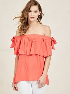 d9ebb22706e7a Jazz up your outfit with this flirty top featuring a shoulder-baring  silhouette. A solid hue makes way for your favorite accessories. Noa Elle