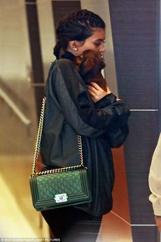 Kylie Jenner wearing Chanel Cruise 2016 Boy Bag in Green with Rainbow Hardware