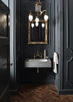 Serious bathroom interior design inspiration, gilded mirrors and marble with grey accents