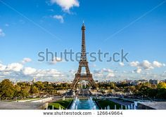 PARIS - NOVEMBER 15: Eiffel tower from Trocadero on November 15, 2012 in Paris. The tallest structure in Paris and the most-visited paid monument in the world, 320 meters tall,  built in 1889. - stock photo