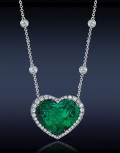 Jacob & Co. Heart Emerald & Diamond Pendant Featuring: Gubelin Certified 11.41 Ct. Colombian Emerald Heart Shape, Surrounded By 1.85 Ct. Pave Set White Diamonds, Mounted In Platinum.