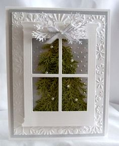 """silver window Christmas Tree card The background layer are embossed with snowflakes. The window has a clear piece of acetate behind it to make it look like a realistic window"""