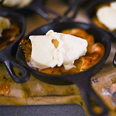 Peanut butter pizookies (pizza cookies) made in mini cast iron skillets and topped with vanilla ice cream.
