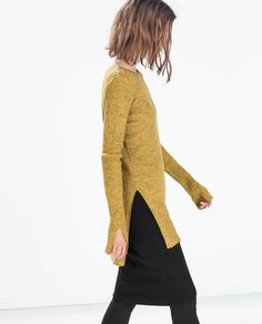 Zara ---- I love how the sweater's side slits are repeated with slits at the end of the sleeve.
