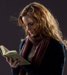Emma Watson as Hermione Granger reading a book