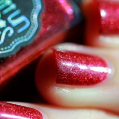 From Il Était Un Vernis:<br>Pinot Noir is a bright ruby red with a strong velvet-like holographic effect... Very elegant, Pinot Noir will become the ally of all the red lovers. Soon your new classic! 12ml<br>Opacity: 2 coats<br>Swatches courtesy of Il Était Un Vernis