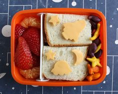 preschool bento - turkey sandwich, outerspace goldfish crackers, strawberries, clementine, space cheese cut-outs