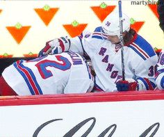 After taking a puck to the knee Carl Hagelin gets comforted by his teammates.  I so love this! How cute are they?!?!?!