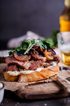 Succulent steak with balsamic-glazed onions and mushrooms and whipped goat's cheese butter all on toasted bread. The ultimate steak sandwich.