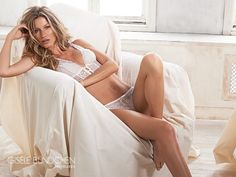 Launching a new season of her Intimates brand, Gisele Bundchen poses in a white lace lingerie look for this campaign image. The model poses on a chair with