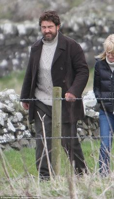 Fitting in nicely: Gerard Butler looked far from Hollywood as he continued filming scenes for his new movie Keeper in the village of Kirkcolm, south-west Scotland