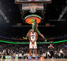 Nate Robinson dunks over Dwight Howard at All Star Game Dunk Contest