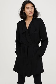 Short trenchcoat in soft, Tencel® lyocell twill with decorative shoulder tabs, small stand-up collar, and draped lapels. Side pockets and Ethical Clothing, Ethical Fashion, Slow Fashion, Woman Fashion, Stylish Outfits, Fashion Outfits, Stylish Clothes, Fashion Tips, Fashion Trends