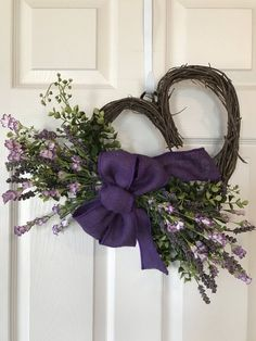 ADORABLE VALENTINE HEART SHAPED WREATH. Grapevine wreath accented with Greenery, Purple Wildflowers and a Burlap bow. Wreath is approximately 15 wide and 17 long. Wreaths are made when ordered and may vary slightly from picture and size. Any questions please dont hesitate to contact! Also Diy Valentines Day Wreath, Mothers Day Wreath, Valentines Design, Valentines Day Decorations, Homemade Valentines, Valentine Ideas, Valentine Crafts, Dorm Wreath, Xmas Wreaths