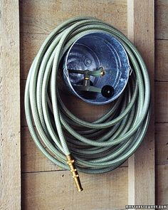 galvanized pail as garden hose storage