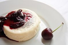 Vanilla Panna Cotta with Cherry, Balsamic, and Rosemary Compote —