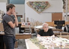 Mark Zuckerberg and Frank Gehry inspect a scale model of the insides.