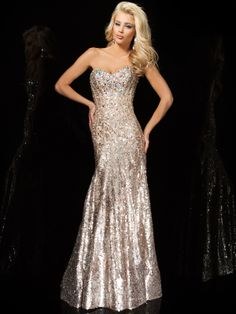 Dazzle everyone in this sparkling Tony Bowls Evenings prom dress. Jewels on prom dresses are a huge trend this year. This sequin Tony Bowls Evenings prom dress TBE11425 has a sweetheart neckline, shimmering bodice adorned with novelty crystals accents, and a mermaid skirt. Removable straps and matching shawl included. Rock this at Prom and be a shining star. Features:   Available in sizes 0 through 16  Colors include champagne  Dress style accented by a sweetheart neckline  Length (Waist to…