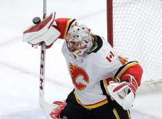 Calgary Flames goaltender Mike Smith makes a save during the second period of the team's NHL hockey game against the Chicago Blackhawks on Tuesday, Feb. 6, 2018, in Chicago. (AP Photo/Charles Rex Arbogast)