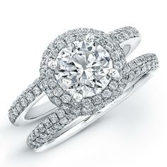 Round Engagement Ring With Halo And Side Triangles 47