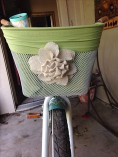 DIY bicycle basket Bike Basket liner   I bought a Bell bike basket from walmart - about 16 dollars- I used a pillow case and a magnetic lamp shade burlap flower from hobby lobby