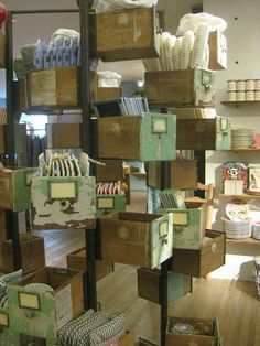 """This is just FUN!!!! I love the wrap around and the vintage drawers. It is totally honoring what is was but making it something new.... FUN!!!! Original pin """"gotta love Anthro's displays!"""""""