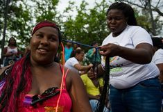 A woman gets an Afro-Colombian hairstyle during the 9th contest of Afro-hairdressers, in Cali, Valle del Cauca departament, Colombia, on May 12, 2013. The Afro hairstyles have their origins in the time of slavery, when women sat to comb their children hair after work. (Photo by Luis Robayo/AFP Photo) http://avaxnews.net/appealing/The_9th_Contest_of_Afro-hairdressers.html #avaxnews.net