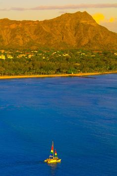 Catamaran cruising from Waikiki Beach with Diamond Head in back, Honolulu, Oahu, Hawaii, USA