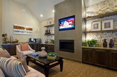 Love the open shelving and stonework... doesn't have to be all about the fireplace!