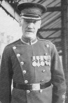 Ernest Edward Thomas in older age with his medals. British soldier who fired the first shot of WWI between Britain and Germany.