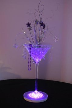 at this fab martini vase decoration idea! Why not do this for your NYE party and use our martini vases! Birthday Decorations, Wedding Decorations, Martini Party, Purple Party, Party Centerpieces, Martini Glass Centerpiece, Floral Centrepieces, Masquerade Party, 50th Birthday Party