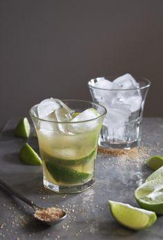 caipirinha cocktail: 1 lime, quartered about 2 teaspoons raw sugar 2 ounces cachaça