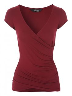 Update your wardrobe essentials this season with this cherry red wrap top. Detailed with a figure hugging fit, side ruching and a low plunge neckline this to...