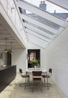 The roof glass gives a sense of drama to the extension, because of the height. (Photo: Tim Crocker)