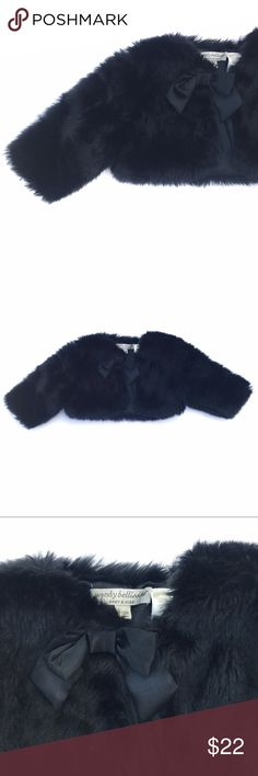 Fur Shrug Beautiful black, faux fur shrug. Snap enclosure at the collar, with a satin bow. EUC, worn once for photos. Size 6-9 Months. Wendy Bellissimo Jackets & Coats