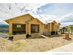 3,072 SQUARE FEET - 4 BEDROOM - 3 BATHROOM - WALK-OUT RANCHER. This is an ideal floor plan to install a 2 bedroom suite downstairs. This Black Mountain property boasts lake and mountain views.