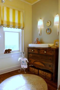 Love the curtain in this room.  It would work perfectly in our little nursery!