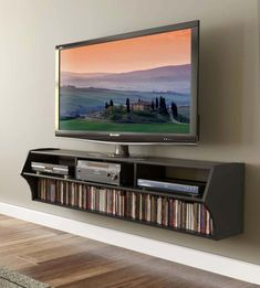 Furniture. massive charcoal tv wall mounted with shelf and bookcase. Practice Watching Favorite Program In TV Wall Mounted With Shelves #WallMountedBathroomFurniture