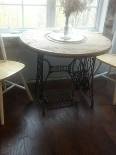 Repurposed wire spool top and sewing machine base! Love it!