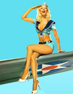 Christina Aguilera, Pin Up style on the military airplane wing. Traditional Pin Up pose.